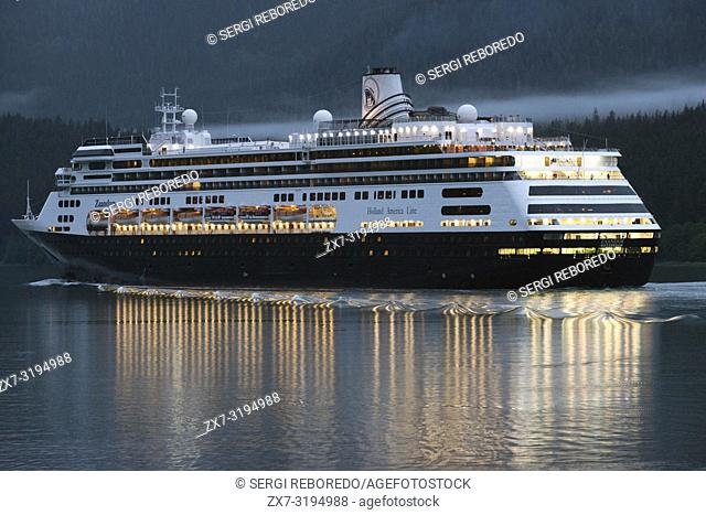 Zaandam, sailing near the South Franklin dock, at night, Juneau, Alaska. Designed to carry fewer guests while providing more space for maximum comfort