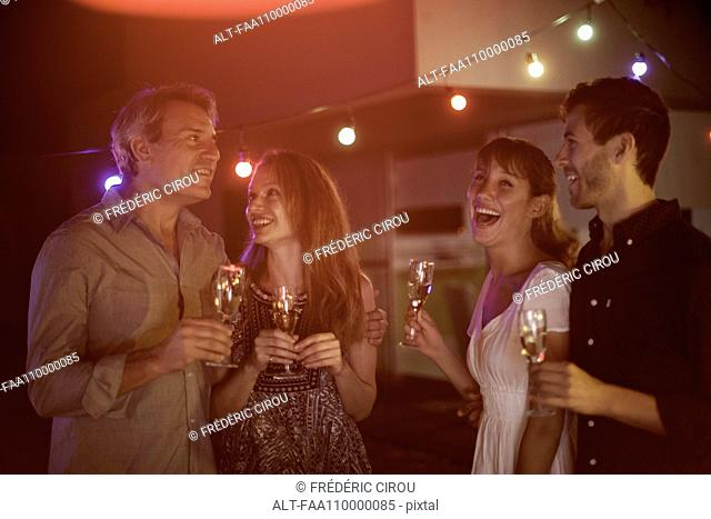 People drinking champagne together outdoors