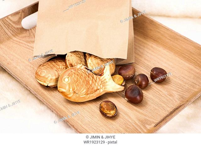 Korean snacks on a tray on the bed