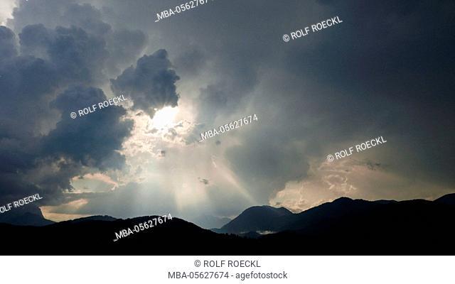 dark clouds and sunrays after summer thunderstorm through Garmisch-Partenkirchen, Bavaria