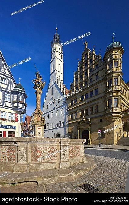 Herterichsbrunnen and town hall tower in Rothenburg ob der Tauber, Middle Franconia, Bavaria, Germany