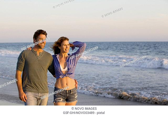 Half-Length Portrait of Smiling Mid-Adult Couple at Beach