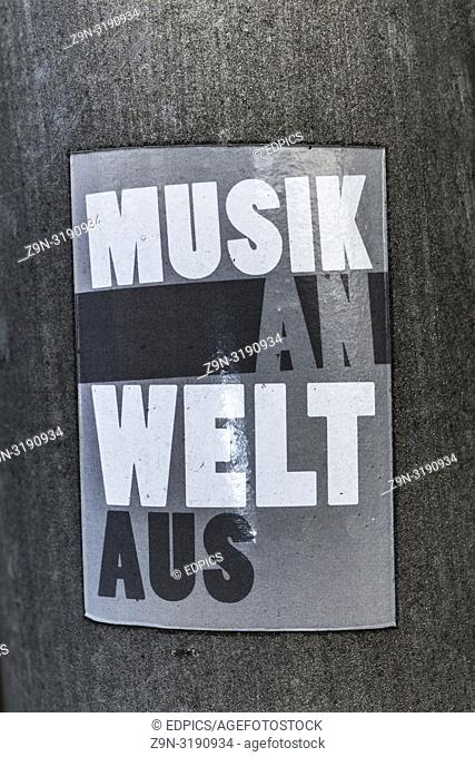 "sticker saying: """"musik an, welt aus"""", """"music on, world off"""", stuttgart, baden-wuerttemberg, germany"