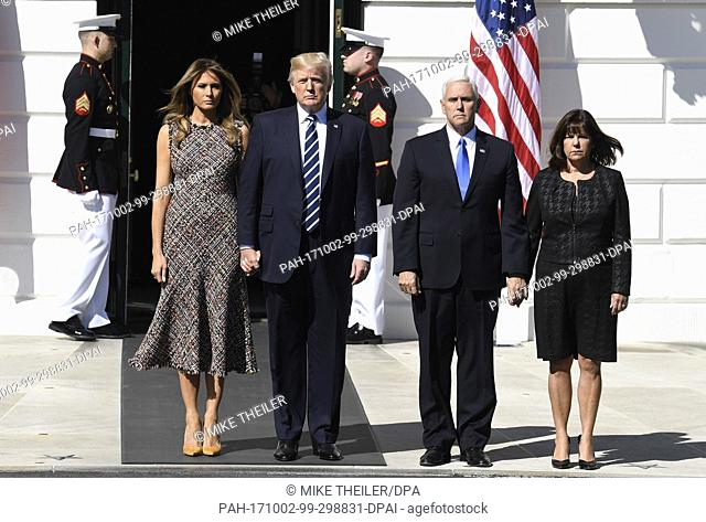 United States President Donald J. Trump (2nd,L), first lady Melania Trump (L), Vice President Mike Pence (2nd,R) and his wife Karen stand at the South Portico...