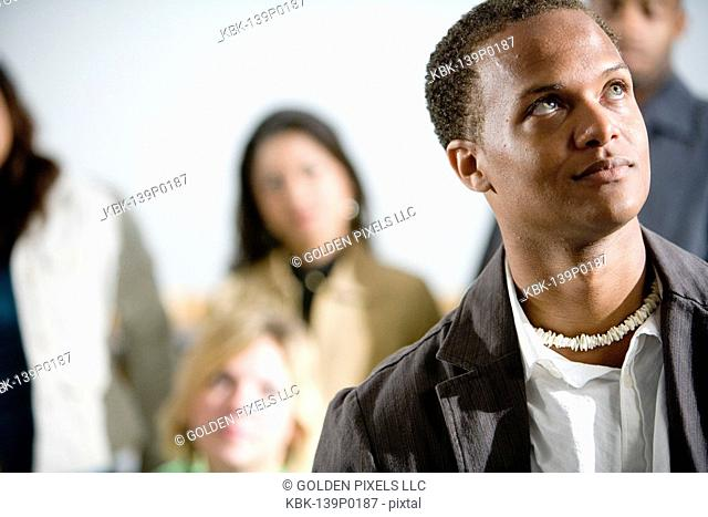 Man standing with group of people in background