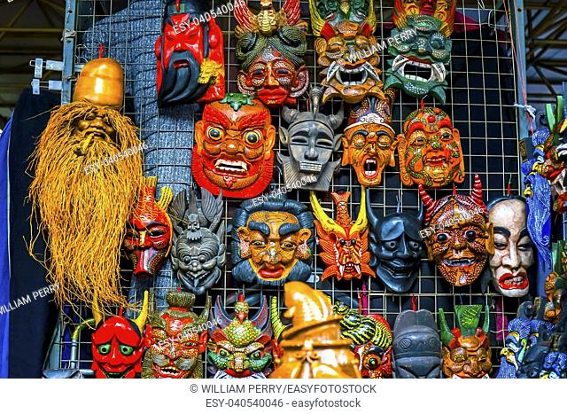 Chinese Replica Wooden Masks Decorations Panjuan Flea Market Beijing China. Panjuan Flea Curio market has many fakes, replicas and copies of older Chinese...