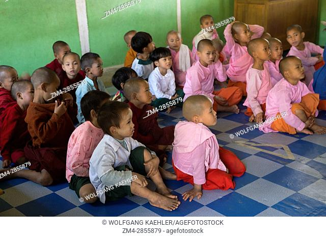 Elementary students in a classroom at the public school of the Aungmyazoo Monastary in Sagaing, a town outside of Mandalay, Myanmar