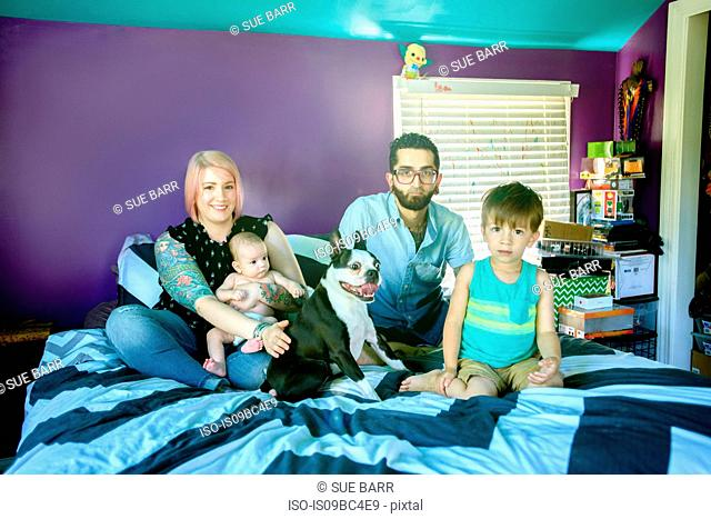 Family on bed in bedroom