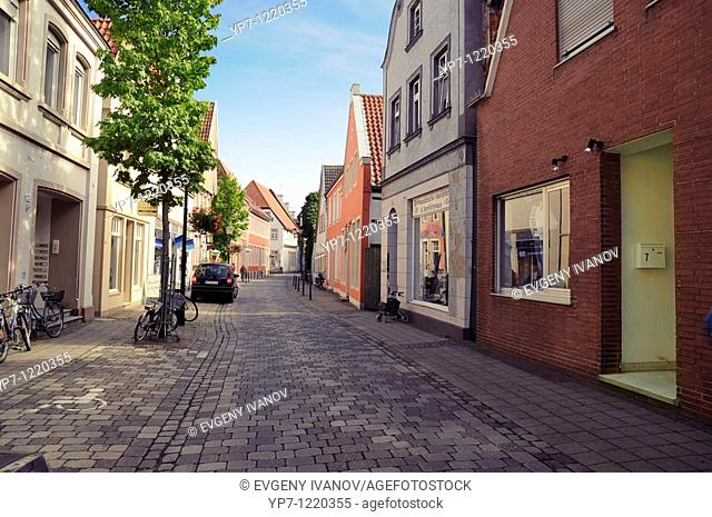 Street of typical small German town Warendorf, empty brick street