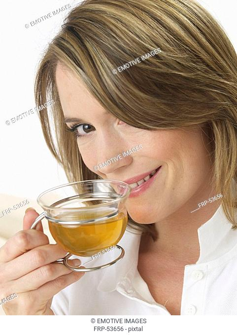 Woman with glass tea cup