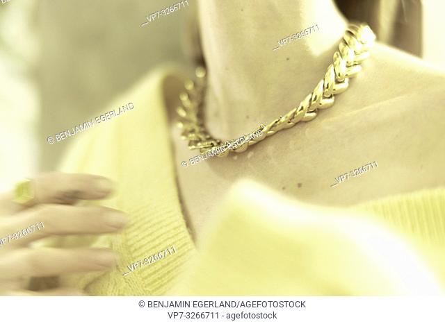 wealthy aristocratic woman wearing golden chain necklace around neck, in Munich, Germany