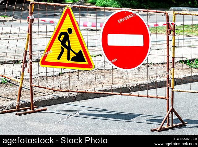 Road works traffic sign at the city street, stop sign! Road under construction