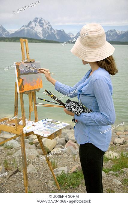 Painter paints Grand Tetons, Wyoming