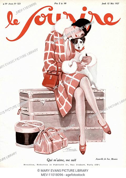 Woman sitting on a trunk case, wearing checked coat with fur trim, red clutch bag and thin necktie, holder her companion a jack russell terrier