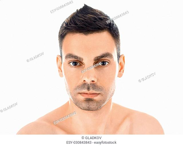 Closeup portrait of young handsome man with healthy clean skin isolated on white background