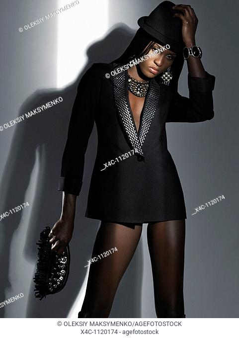 Woman in sexy black outfit High fashion photo