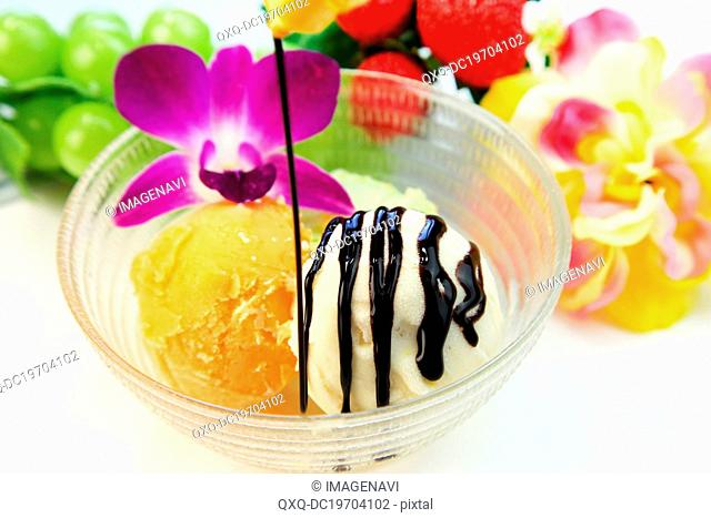 Assorted ice creams with chocolate sauce