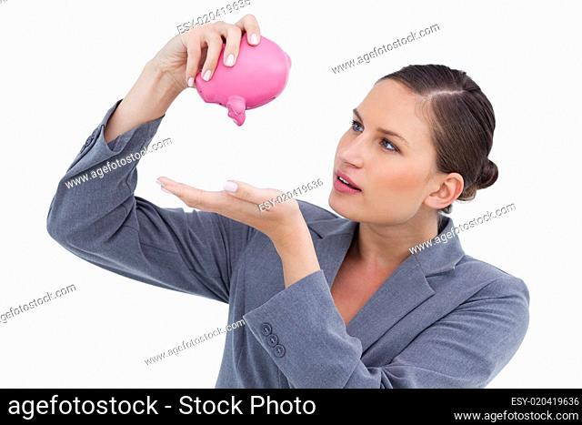 Bank clerk emptying piggy bank