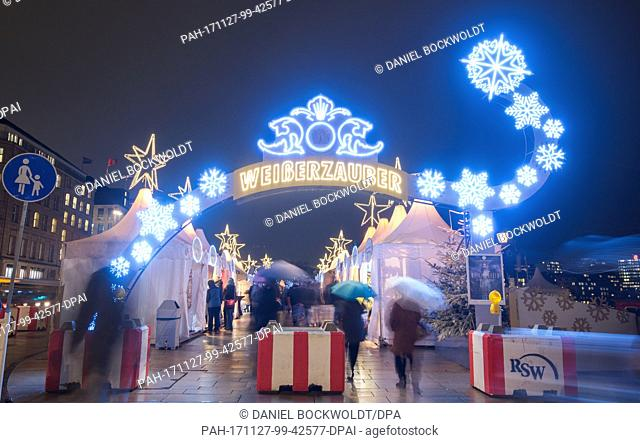 "Visitors walk across the grounds of the """"Weißer Zauber"""" Christmas market at the Jungfernstieg in Hamburg, Germany, 27 November 2017"