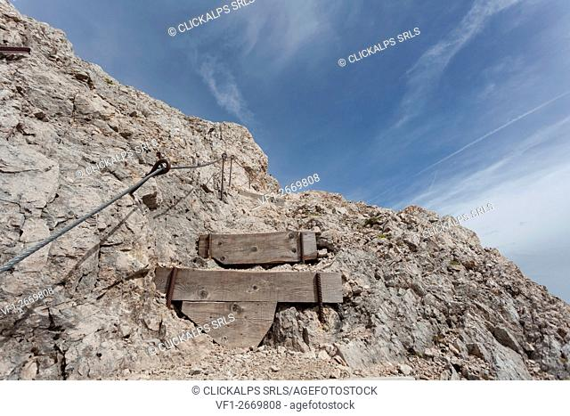 Steps and protection wire in the trenches of Punta Serauta, Marmolada, Dolomites