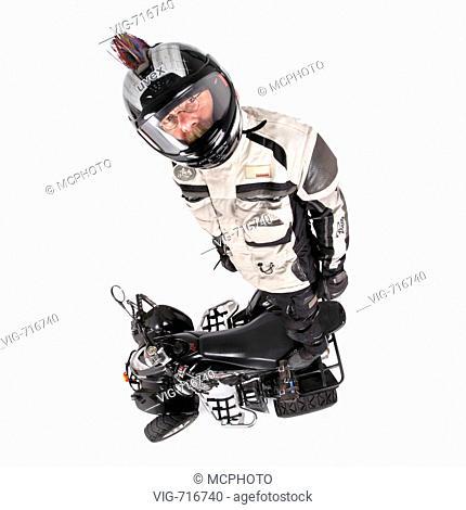 quod biker with helmet standing on his vehicle  - 20/10/2007