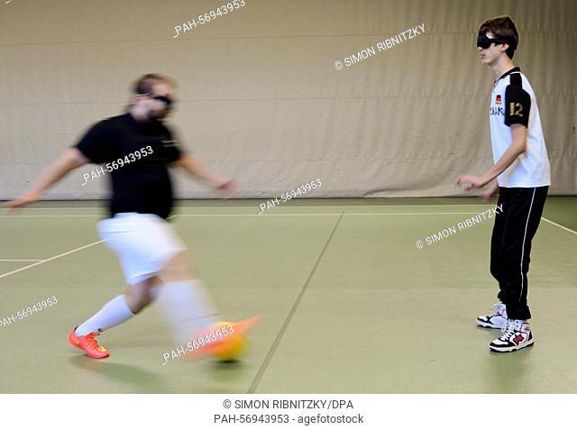 The blind soccer coach Ramon Pryssok runs towards Dorleld Fetahaj during the training of the Post SVMunich in Munich, Germany, 08 March 2015