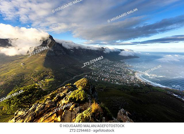 Landscape photo of Camps bay and Table Mountain on a misty morning. Cape Town, South Africa