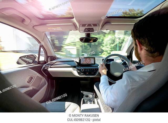 Man driving electric car