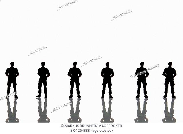 Row of police figures with backlighting