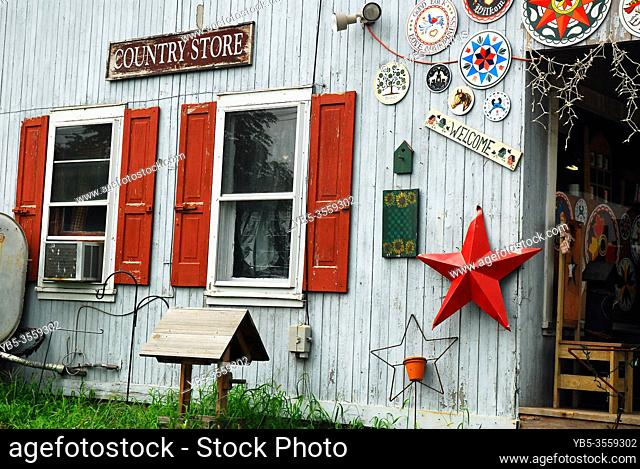 Amish Hex signs and other antiques hang on the exterior wall of a country store in Reading, Pennsylvania