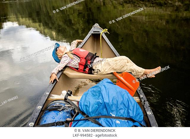 A girl on a canoe trip on the Whanganui River, North Island, New Zealand