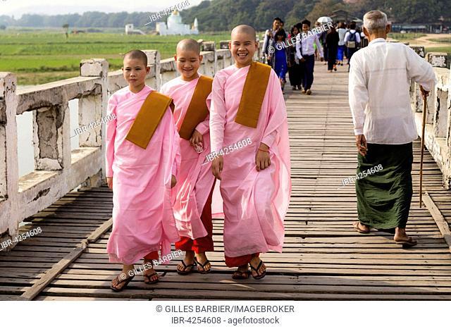 Nuns on U-Bein Bridge, the longest Teak-Wood Bridge in the world, Amarapura, Mandalay, Myanmar