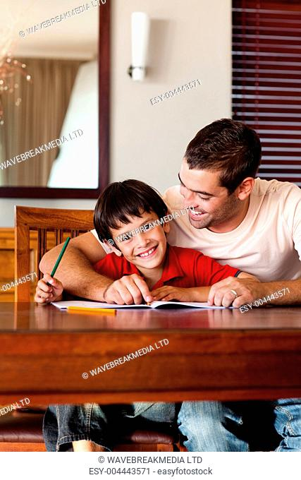 Concentrated father helping his son for homework