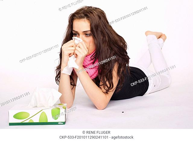 A beautiful young woman, lady, girl, cold, runny nose, headache, tissues, paper hankies, scarf CTK Photo/Rene Fluger , MR