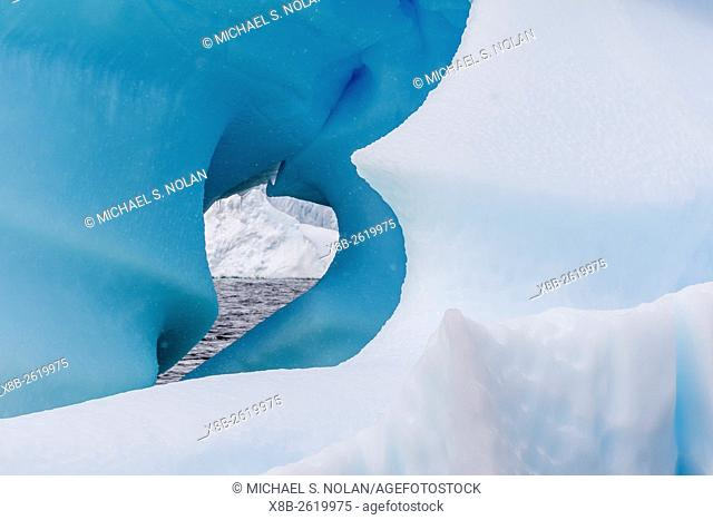 Wind and water sculpted iceberg in Orne Harbor, Antarctica