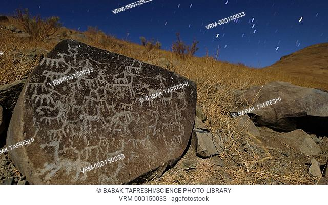 Rock art and star trails. Time-lapse footage of an ancient petroglyph (rock engraving) under the southern night sky, Chile