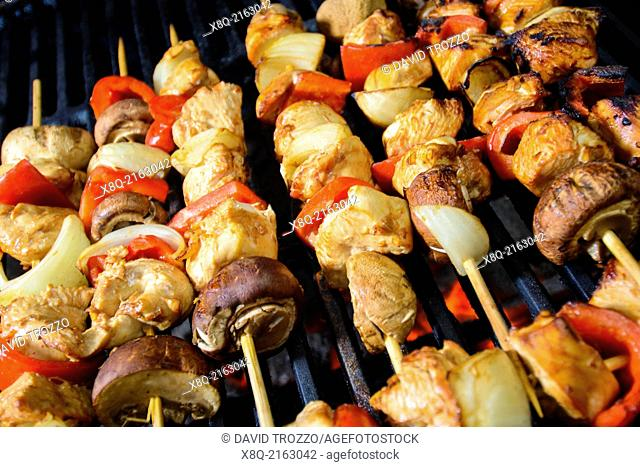 Chicken Shis kebab with mushrooms and peppers prepared over slow burning flame, barbecue style