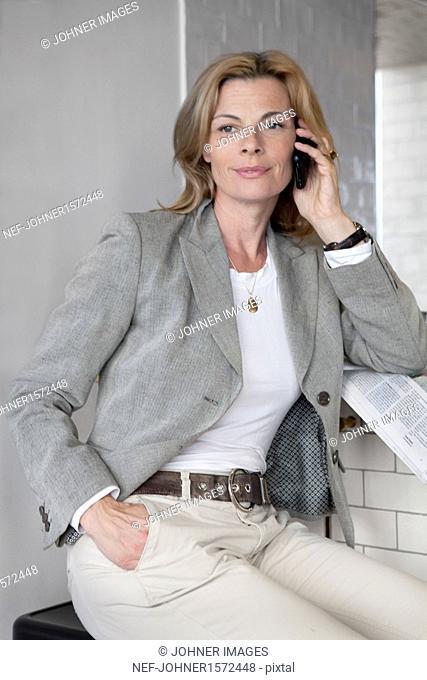 Businesswoman talking via cell phone