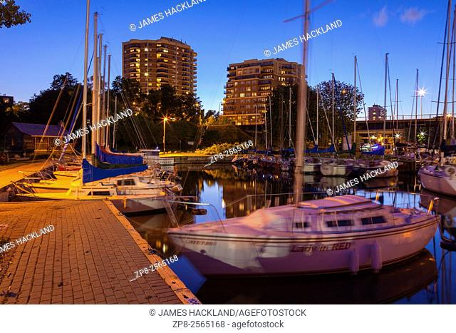 Sailboats at the Oakville Harbour at dusk. Shipyard Park, Oakville, Ontario, Canada