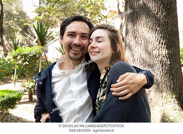 couple hugging in Parque Mexico in Mexico City, Mexico