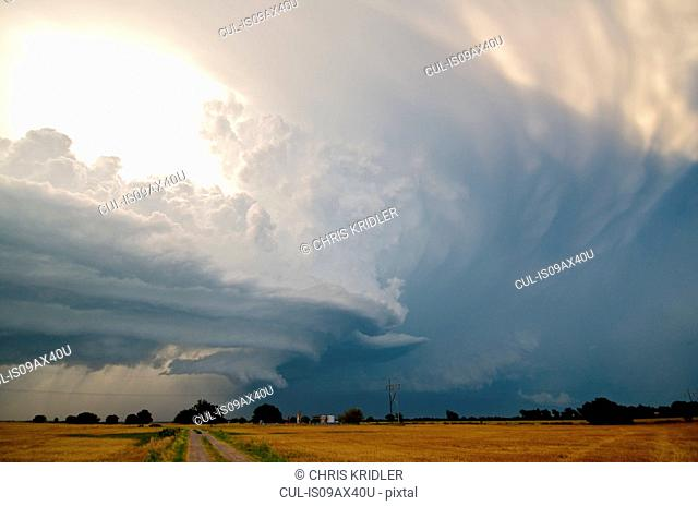Amazing structure evolves in a rotating supercell as two storms collide, looking north toward Piedmont, Oklahoma, USA