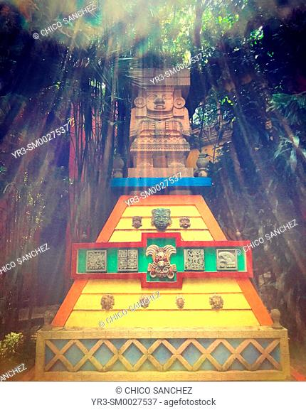 Sunbeams form a pyramid on top of a pyramid decorated with the image of Aztec Rain God Tlaloc in Hacienda de Cortes restaurant in Coyoacan, Mexico City, Mexico