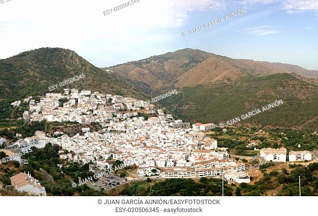 Aerial view of Ojen , white village over a hillside near Marbella, Spain. Panoramic