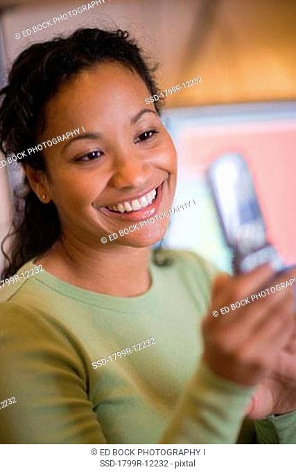 Close-up of a businesswoman text messaging