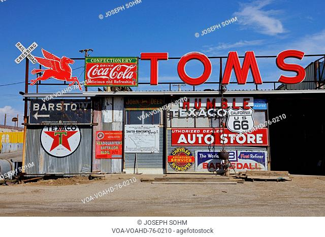 Vintage collection of Americana gas station road signs outside Barstow on historic Route 58, CA