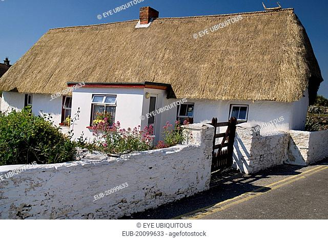 Thatched cottage in fishing village renowned for such dwellings