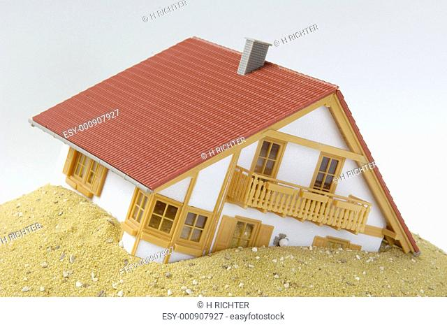 Model house built on sand