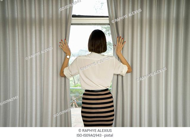 Stylish businesswoman looking out of window
