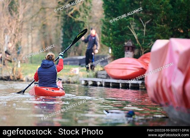 28 March 2020, Brandenburg, Lübben: One of the managers of the boat and second bike rental Gebauer rides a canoe. She's the only one today