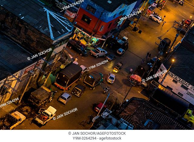 A street of Barrio Triste, a car mechanics neighborhood, is seen from a rooftop during the twilight in Medellín, Colombia, 8 December 2017